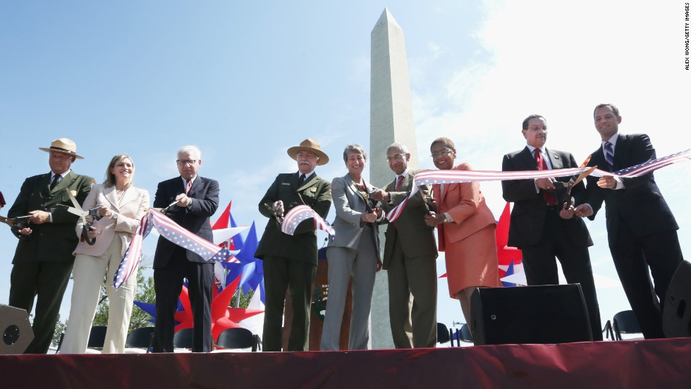 The Washington Monument is reopening after a 2011 earthquake caused $15 million in damage. Cutting the ribbon Monday, May 12, were, from left, National Mall and Memorial Parks Superintendent Robert Vogel; Caroline Cunningham, president of the Trust for the National Mall; David Rubenstein, co-founder and co-CEO of the Carlyle Group; National Park Service Director Jonathan Jarvis; U.S. Interior Secretary Sally Jewell; counselor to President Obama John Podesta; Rep. Eleanor Holmes Norton, D-D.C.; and D.C. Mayor Vincent Gray (with unidentified man).