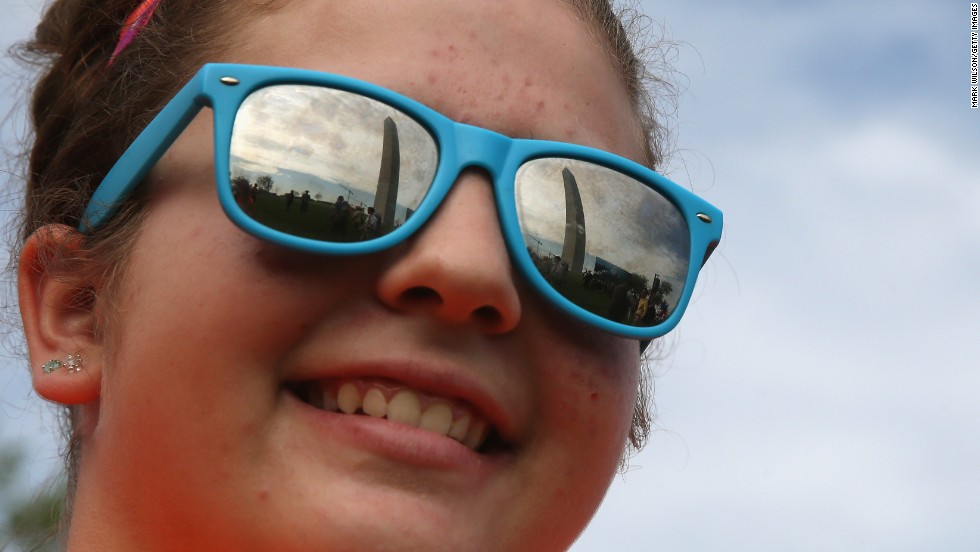 The Washington Monument is reflected in tourist Lani Walatka's sunglasses.