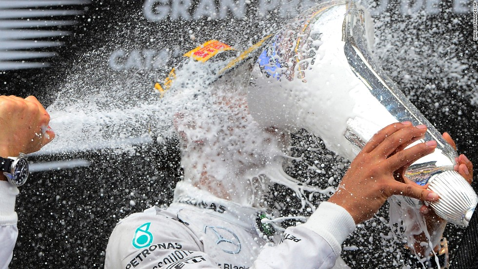 Mercedes driver Lewis Hamilton of Britain celebrates on the podium after winning the Spain Formula One Grand Prix at the Barcelona Catalunya racetrack in Montmelo, Spain, on Sunday, May 11.