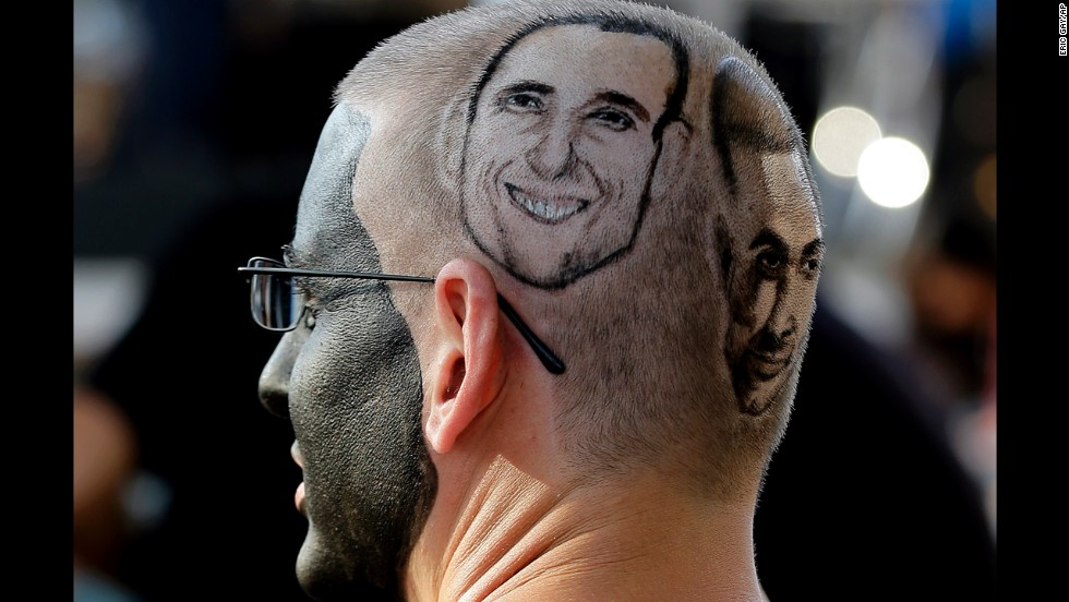 San Antonio Spurs fan Paul Fisher waits for the start of Game 2 of the NBA playoff series between the Spurs and the Portland Trail Blazers in San Antonio on Thursday, May 8. His head is marked with the likenesses of Spurs players Manu Ginobili and Tony Parker.