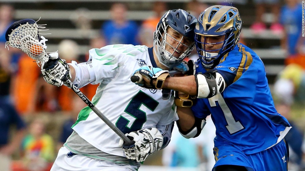 Kyle Dixon of the Chesapeake Bayhawks, left, runs into Jake Tripuka of the Charlotte Hounds during a game at American Legion Memorial Stadium in Charlotte, North Carolina, on Saturday, May 10.
