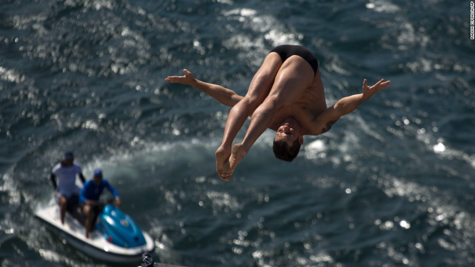 An athlete dives from a Red Bull Cliff Diving World Series platform during a training session in Havana, Cuba, on Thursday, May 8.