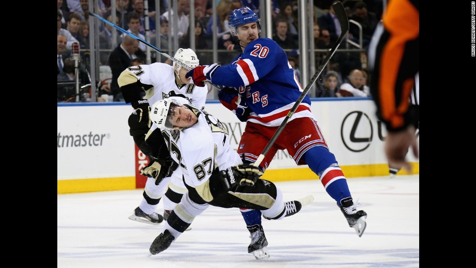 Sidney Crosby of the Pittsburgh Penguins is checked by Chris Kreider of the New York Rangers during the NHL Stanley Cup playoffs at Madison Square Garden in New York on Wednesday, May 7.