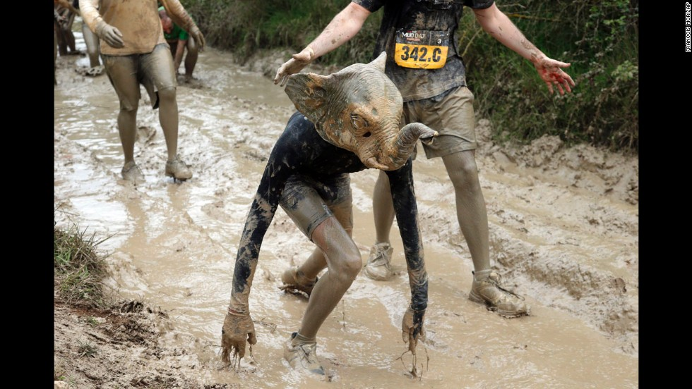 A Mud Day participant wearing an elephant mask competes in Beynes, France, on Thursday, May 8. The eight-mile course had more than 20 obstacles, most of them set in mud.