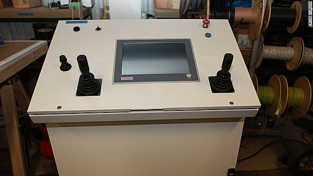 Engineers can control the robot arm remotely from this command console, allowing them to remain safe from harmful radiation.