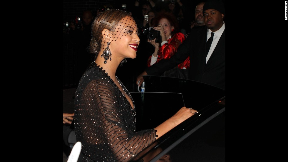 "The onlooker also told People magazine that Solange didn't look disheveled but did appear ""mad as hell."" Beyonce seemed collected, smiling for the crowd outside the hotel."