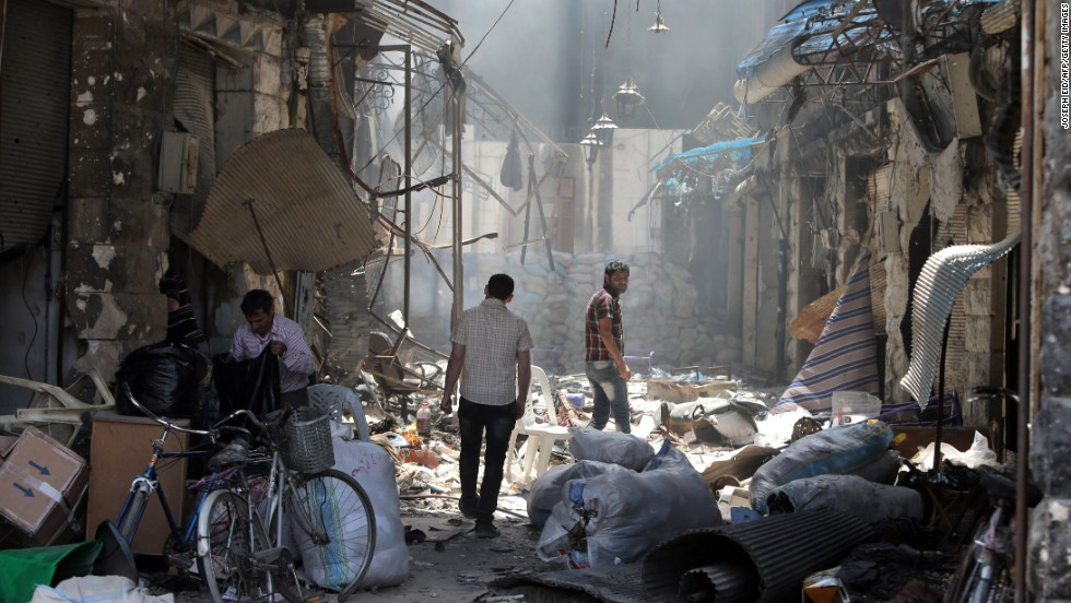 Residents return to their destroyed neighborhood on May 12. Rebel forces in the Old City were under government siege for nearly two years before the deal to evacuate.
