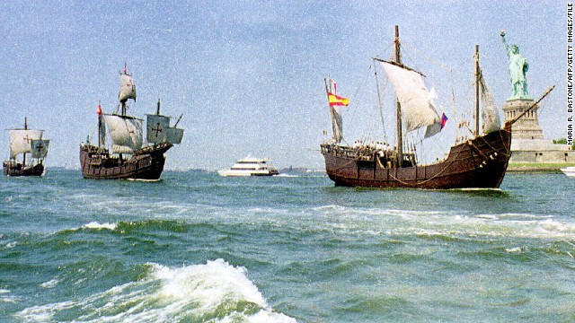 Replicas of Christopher Columbus' ships, the Nina, Pinta and Santa Maria, sail past the Statue of Liberty.