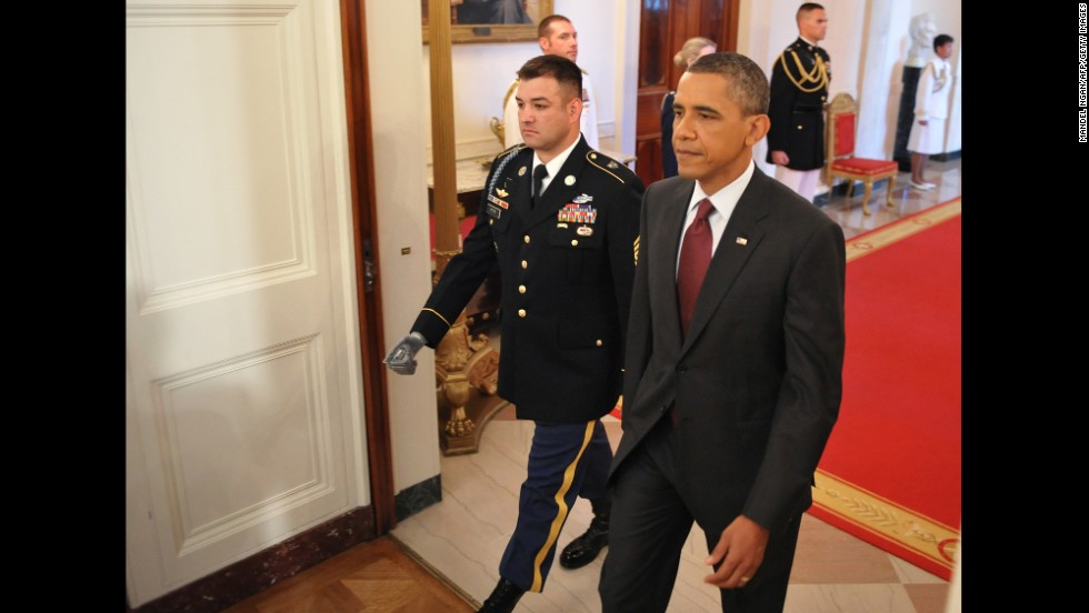Obama walks with Army Sgt. 1st Class Leroy Arthur Petry, who received the Medal of Honor in July 2011. Petry was cited for his actions during a battle in Paktya province, Afghanistan, on May 26, 2008, which included picking up an enemy grenade thrown at him and fellow soldiers. As he was about to throw it away, the grenade exploded and blew off his right hand, according to his citation.