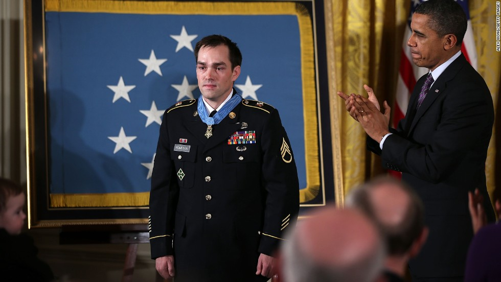 "President Obama presents the Medal of Honor to Army Staff Sgt. Clinton Romesha at the White House on February 11, 2013. Wounded early in the battle at Command Outpost Keating on October 3, 2009, Romesha ""continually exposed himself to heavy enemy fire as he moved confidently about the battlefield engaging and destroying multiple enemy targets,"" according to the Army."