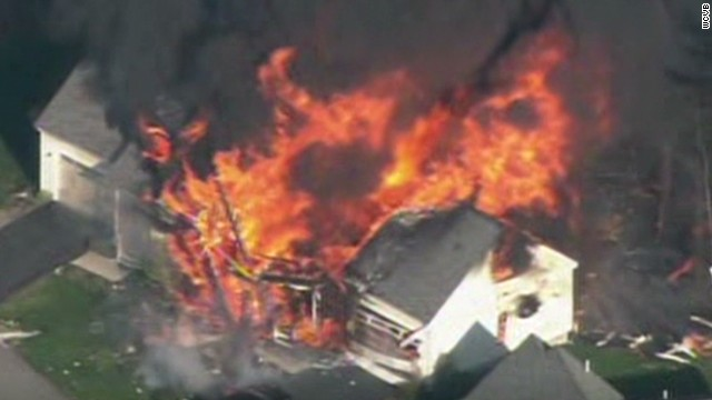 Home explodes after officer is killed