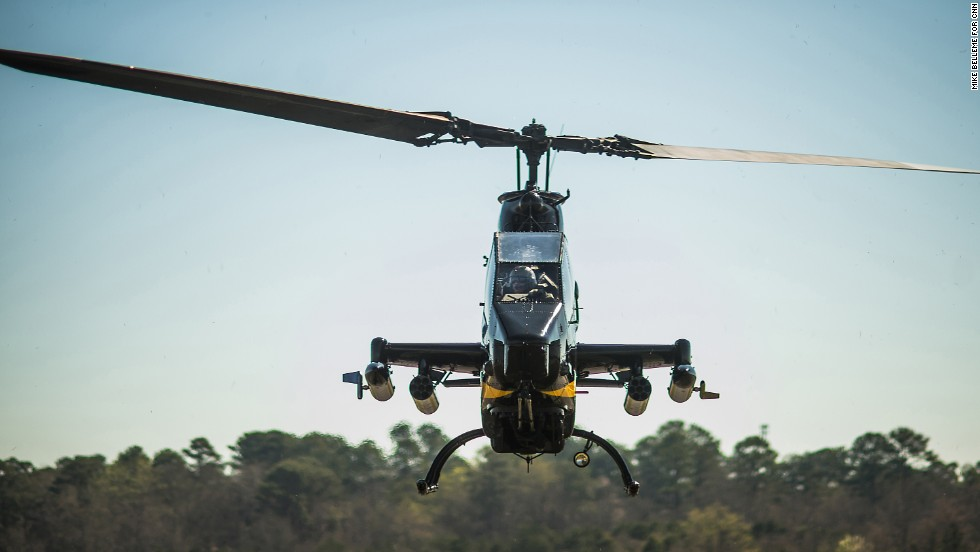 A retired Cobra AH-1 helicopter from the Army Aviation Heritage Foundation lands at the Columbus, Georgia, airport before a weekend air show on Friday, March 14.