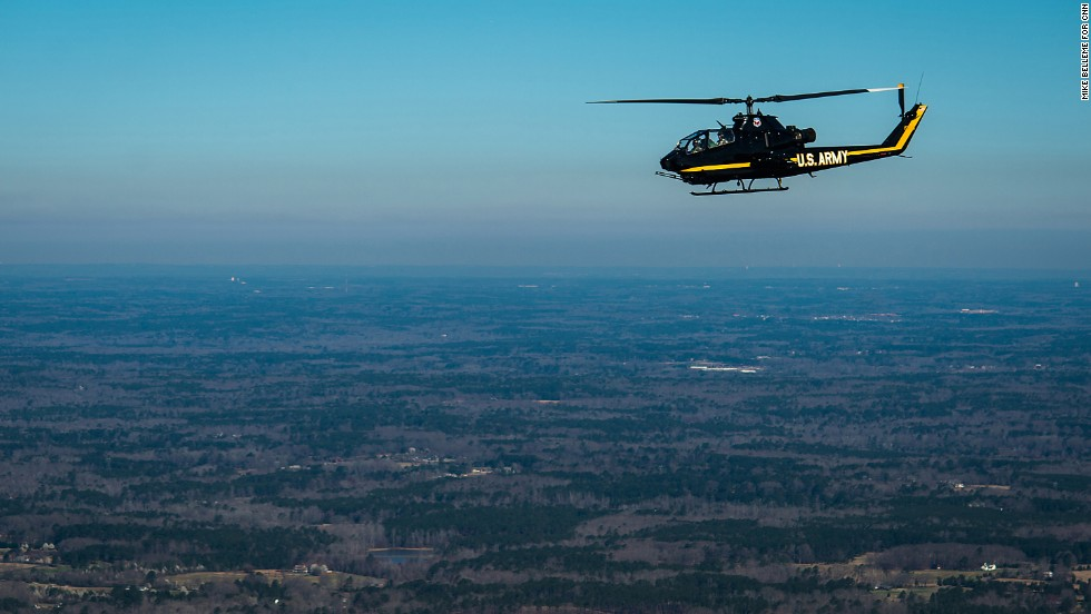 A retired Cobra AH-1 Army helicopter flies between the Henry County Airport and the Columbus Airport near Atlanta on the way to an air show in Columbus.