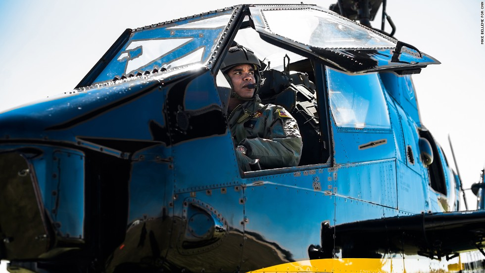 St. Claire Williams, in a Cobra AH-1 Army helicopter at the Henry County Airport, is a former Marine who saw combat in Afghanistan and is now a police sniper in Roswell, Georgia.
