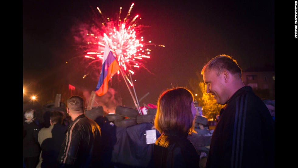 People celebrate with fireworks in Donetsk on May 12 as separatists declared independence for the Donetsk region.