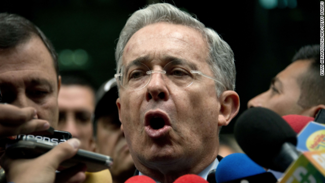 Former Colombian President (2002-2010) Alvaro Uribe speaks to the press as he leaves the public prosecutor's office in Bogota, Colombia, on May 13, 2014. Uribe challenged the public prosecutor's office, which had summoned him to formalize an accusation he made last week in which he accused close aides of President Juan Manuel Santos of pouring money received by drug traffickers into the presidential campaign for the 2010 election, and announced he will remit the case to an organ of control. AFP PHOTO/Eitan Abramovich (Photo credit should read EITAN ABRAMOVICH/AFP/Getty Images)