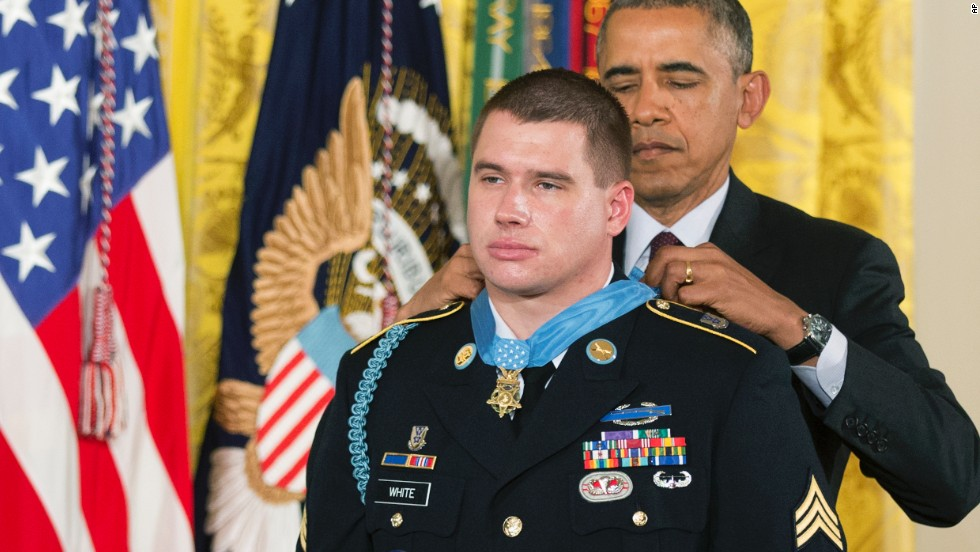 Army Sgt. Kyle White receives the Medal of Honor during a ceremony at the White House on May 13. He was recognized for repeatedly exposing himself to enemy fire in Afghanistan while trying to save the lives of fellow soldiers in November 2007.