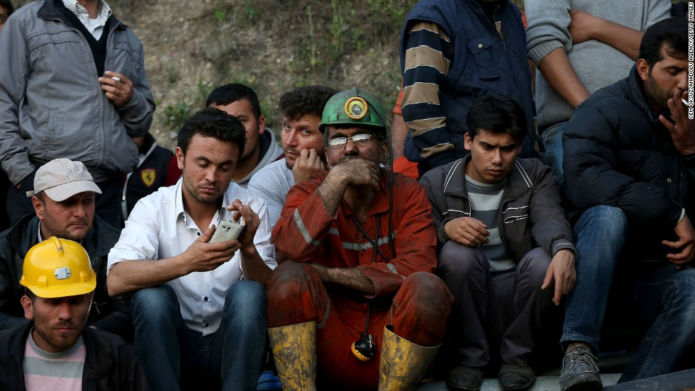"Miners and relatives wait outside the mine on May 13. Turkish Energy Minister Taner Yildiz said officials turned an exit pipe ""into a clean air pipe,"" so ""there is fresh air being given in places where there is no fire."""