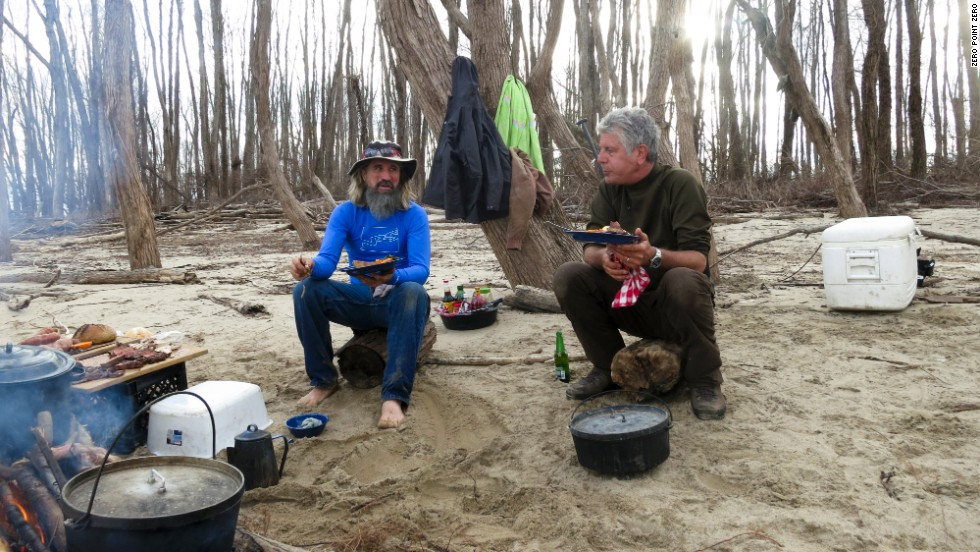 Tony and guide John Ruskey eat a campfire lunch on a sandbar in the middle of the Mississippi River.