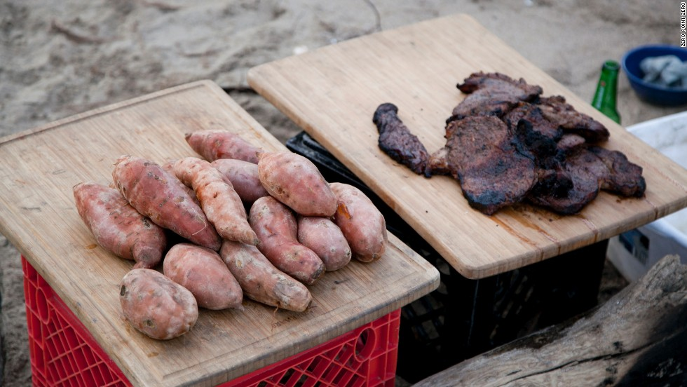 Sweet potatoes and grilled meat pick up great flavor from the campfire.