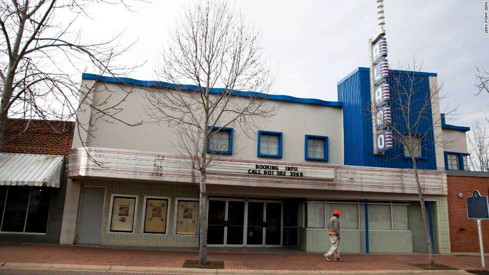 A man walks past the Alamo Theatre on Jackson's historic Farish Street.