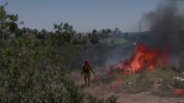 Hot winds fan San Diego-area wildfire