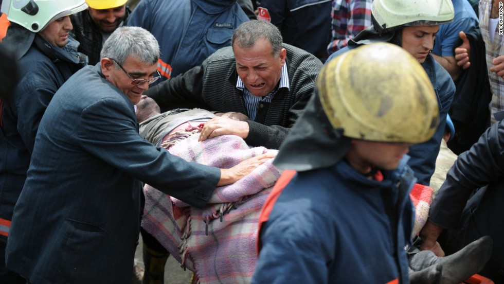 A man weeps over the body of a miner being pulled from the mine in Soma on May 14.