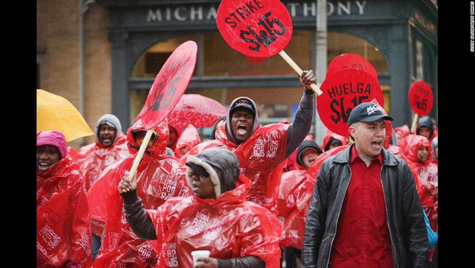 Fast-food workers and activists demonstrate outside a McDonald's in downtown Chicago.