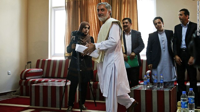 Afghan presidential candidate Abdullah Abdullah arrives for a news conference in Kabul, Afghanistan on May 14, 2014.