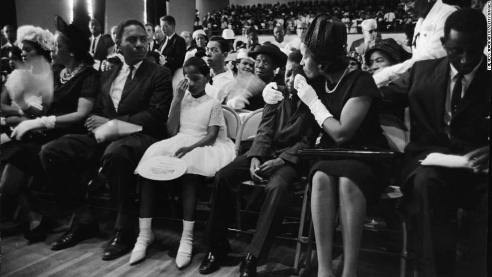Myrlie Evers, widow of civil rights activist Medgar Evers, comforts their son Darrell while their daughter, Reena, wipes her tears during Evers' funeral on June 18, 1963. Evers was assassinated days earlier at his home in Jackson, Mississippi.