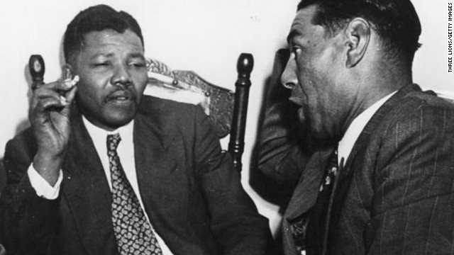 Nelson Mandela, then-president of the African National Congress, left, speaks with a teacher sometime in 1964.