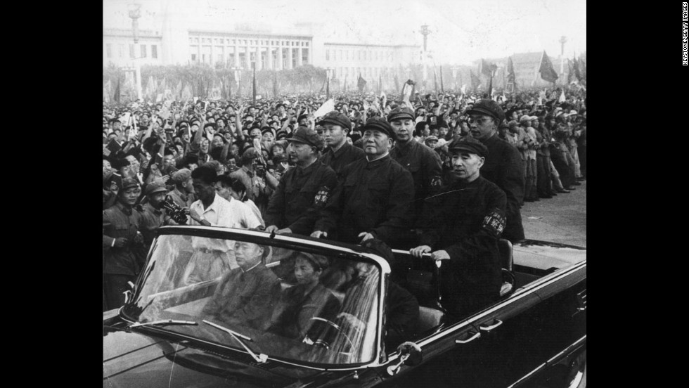 Chinese leader Mao Zedong, standing front and center, rides through a Tiananmen Square rally in Beijing in 1966. In May of that year, Mao launched the Cultural Revolution to enforce communism and get rid of old institutions and his political enemies. The political movement careened out of control and led to massive political purges, deaths and destruction before it ended in 1976.