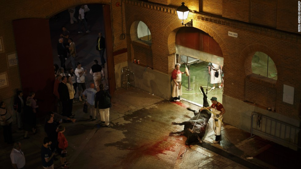 A butcher washes a dead bull Wednesday, May 14, outside the Las Ventas bullfighting ring in Madrid. Bullfighting season runs from March to October in Spain.