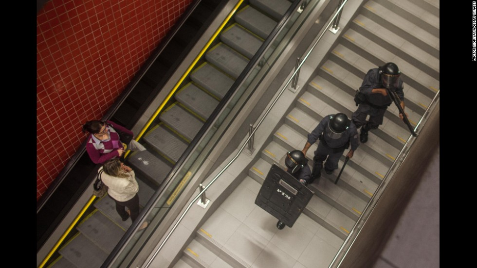Police patrol a subway station during a Sao Paulo protest on May 15.