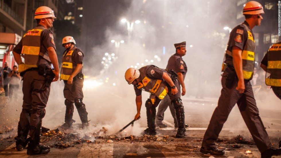 Military personnel put out a fire in a Sao Paulo street on May 15.