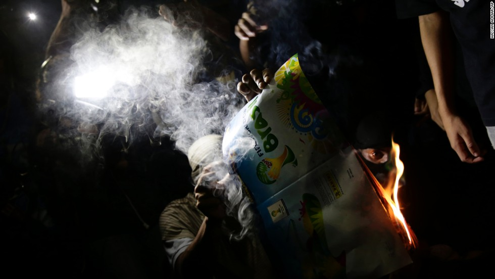 Protesters burn a World Cup magazine in Rio de Janeiro on May 15.