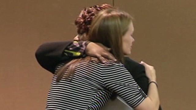 ga dnt widow hugs victim _00010301.jpg