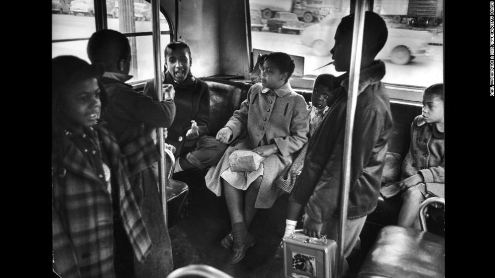 Linda Brown, center, and her sister Terry Lynn, far right, take a bus to Monroe Elementary School, an all-black school in Topeka, in 1953.