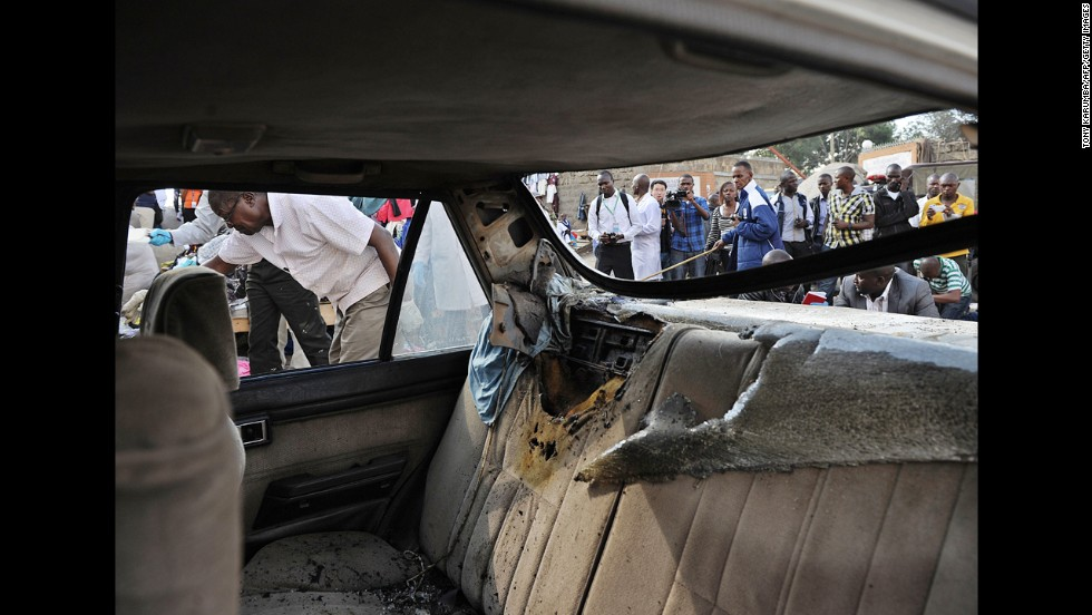 Police investigators comb through the scene of an explosion in Nairobi on May 16.