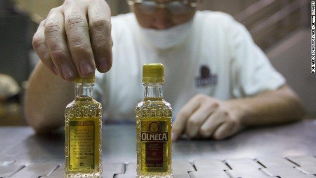 "A ""Jalisco Colonial Distillery"" employee checks bottles of tequila in Arandas, Mexico, 11 January 2008. In the last 15 years, tequila ceased to be considered a ""bricklayer's drink"" in Mexico and has become fashionable all over the world, demonstrating that their international sales strategy has been a great success. AFP PHOTO/Ronaldo SCHEMIDT (Photo credit should read Ronaldo Schemidt/AFP/Getty Images)"
