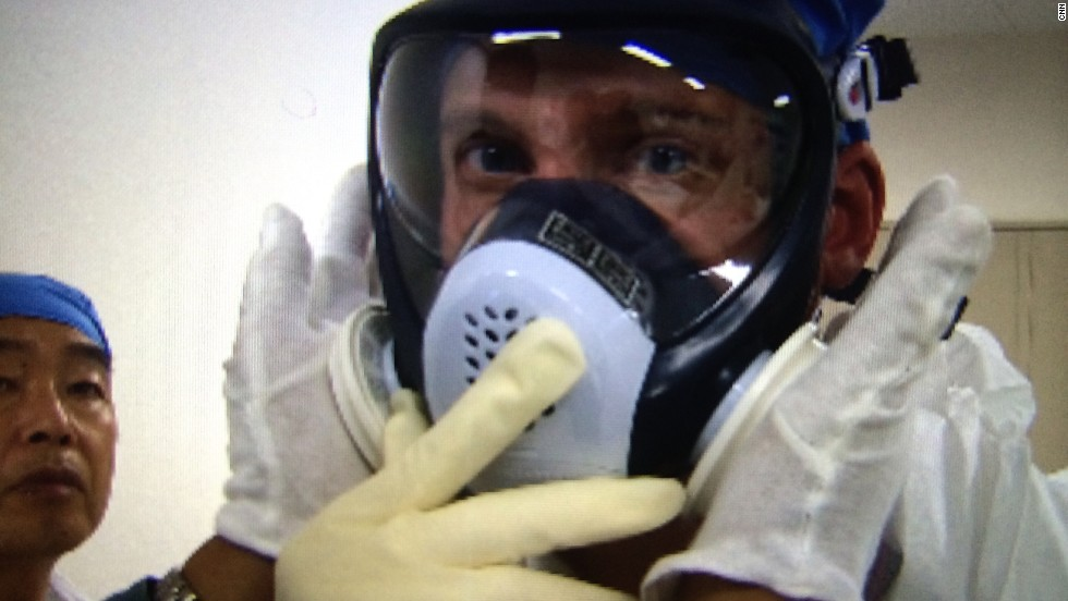 CNN correspondent Will Ripley is fitted with gear to protect him from radiation.