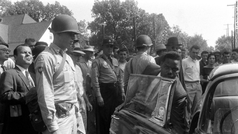 Members of the Little Rock Nine arrive at school, only to be turned away by Arkansas National Guardsmen.