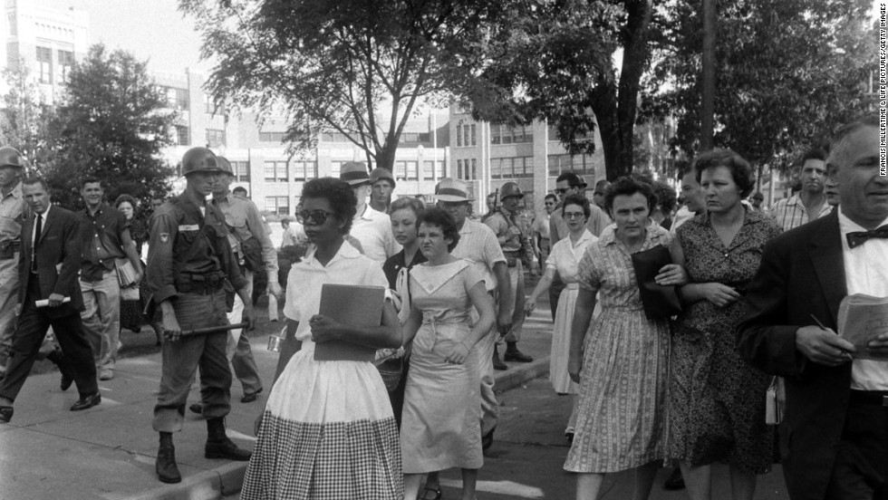 "Arguably the most critical school desegregation battle in American history took place in 1957, three years after the Supreme Court's landmark Brown v. Board of Education ruling, when nine African-American students -- known ever after as the Little Rock Nine -- integrated Arkansas' Little Rock Central High School. On September 4, 1957 -- the first day of school -- a crush of reporters and photographers chronicled the scene as Arkansas National Guardsmen blocked 15-year-old Elizabeth Eckford, the first of the nine to arrive, from entering school grounds. <a href=""http://life.time.com/history/little-rock-nine-1957-photos/#1"" target=""_blank"">See more of LIFE's coverage of the Little Rock Nine</a>."