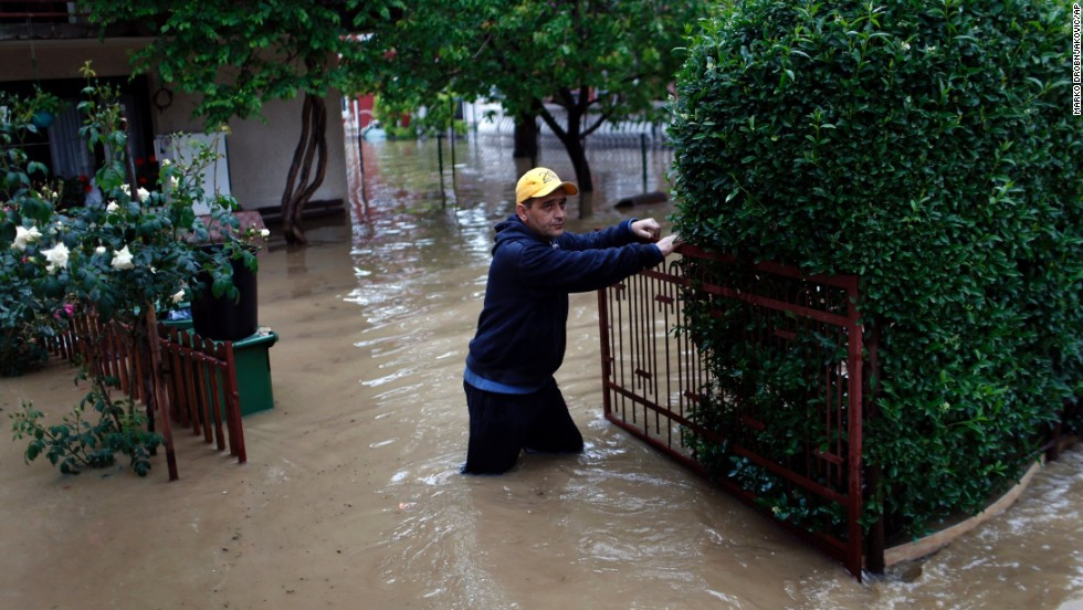 A man walks outside his home after severe floods in Obrenovac on May 16.