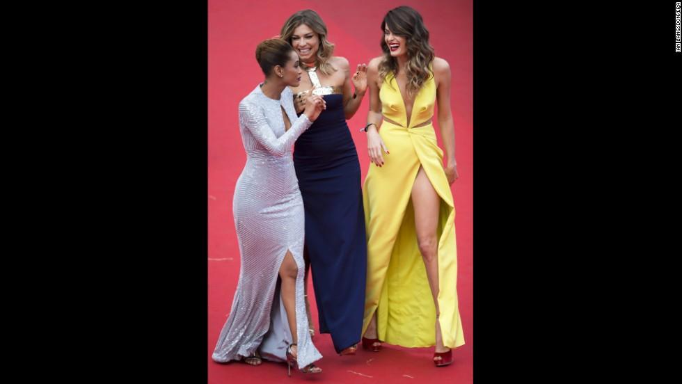 From left, actress Tais Araujo and models Grazi Massafera and Isabeli Fontana on May 17