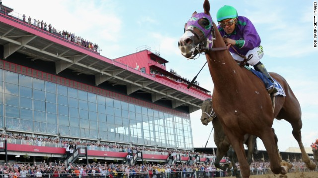 BALTIMORE, MD - MAY 17:  California Chrome #3, ridden by Victor Espinoza, races to the finish line enroute to winning the 139th running of the Preakness Stakes at Pimlico Race Course on May 17, 2014 in Baltimore, Maryland.  (Photo by Rob Carr/Getty Images)