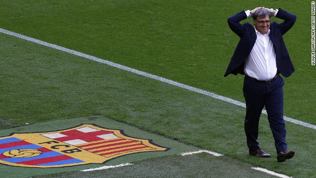 """Barcelona's Argentinian coach Gerardo """"Tata"""" Martino reacts during the Spanish league football match FC Barcelona vs Club Atletico de Madrid at the Camp Nou stadium in Barcelona on May 17, 2014. AFP PHOTO/ QUIQUE GARCIA QUIQUE GARCIA/AFP/Getty Images"""