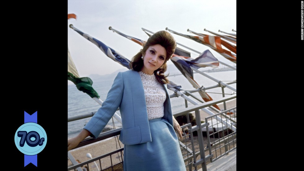 "Italian actress Gina Lollobrigida contrasts a demure powder blue suit with racy lace on top at Cannes in 1972. She starred in films such as ""The Hunchback of Notre Dame"" (1956) but as her career slowed, she established herself as a photojournalist and sculptor, even gaining an exclusive interview with Communist dictator Fidel Castro."