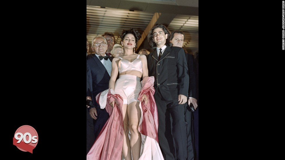 "The 90s saw a change in tack for red carpet attendees. Madonna kicked off the trend by wearing her Jean-Paul Gaultier underwear as outerwear at the screening of her movie ""In Bed with Madonna"" in 1991. Director Alek Keshishian (left) looks on awkwardly."
