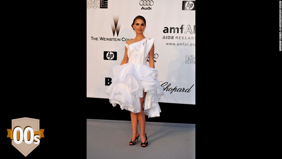 Natalie Portman arrives at amfAR's Cinema Against AIDS 2008 benefit in a cut-out Givenchy Haute Couture dress. The swan-lake-meets-origami gown marked a move back to a more demure red carpet style after the rising hemlines of the 90s.